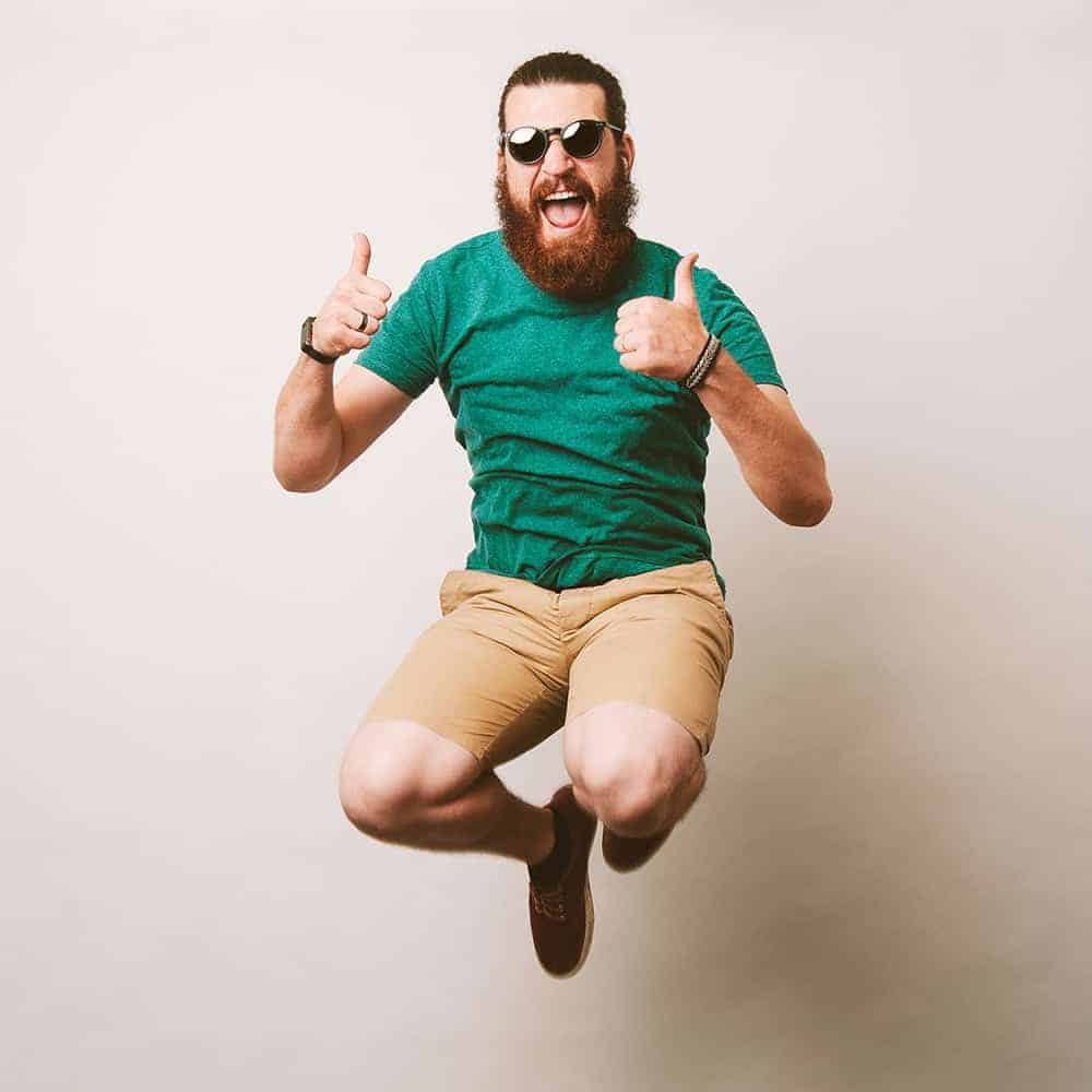 Cheerful bearded hipster man with sunglasses